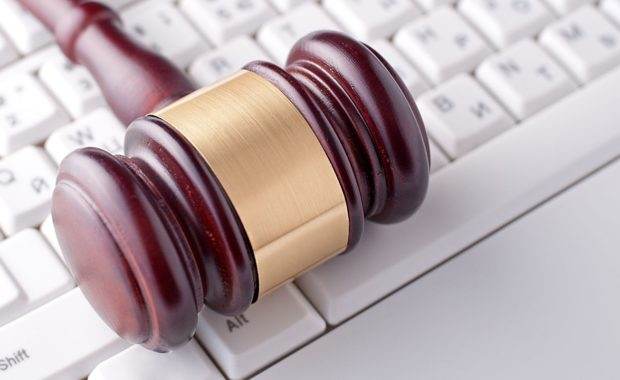 a gavel on top of a keyboard which portrays law firms using social media that is used for basic marketing