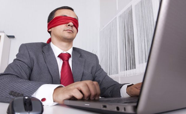 a man with a blindfold symbolizing the need for websites to use ADA compliance