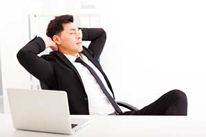 Businessman able to relax after setting up email automation and lead generation through marketing automation