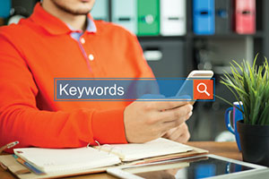 Digital marketer at seo company performing keyword research for content marketing strategy