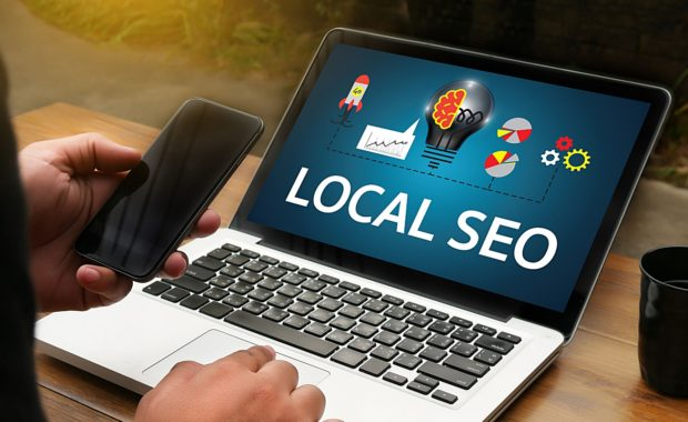 a slideshow describing local SEO on a laptop computer that a digital marketing agency is showing to the owner of a local business