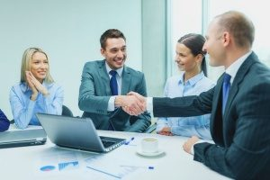 an insurance broker that is shaking hands with the owner of a digital marketing agency to discuss how the brokerage can generate more business leads in the coming months