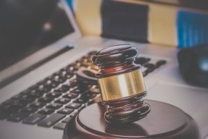 gavel and laptop computer symbolizing the need for law firms to have a good social media marketing plan and strategy