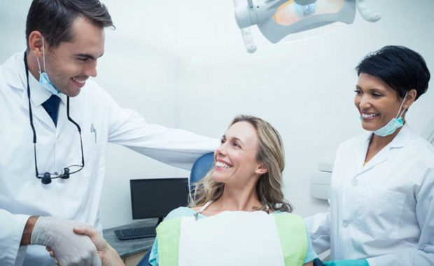 dentist consulting a new patient he received from email marketing and outreach marketing