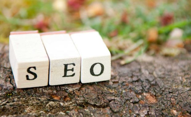 three blocks laying on dirt representing organic SEO which is key to any good dental marketing campaign