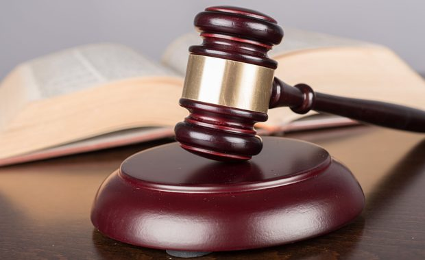 a gavel and law book that belong to a law firm that benefits greatly from attorney web marketing