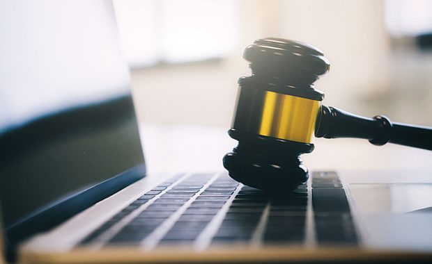 a gavel resting on a laptop to symbolize the importance of a law firm website design for any attorney or law firm