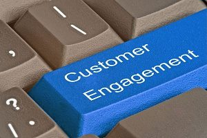 customer engagement button on a keyboard representing its importance for a successful social media marketing campaign