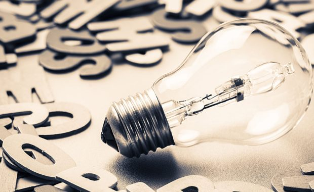 a lightbulb surrounded by letters to symbolize the importance of effective content marketing in any good digital marketing campaign