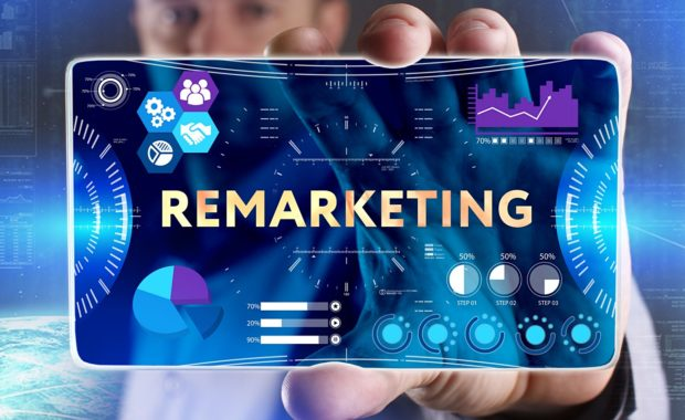 a man holding a diagram that shows the key components of remarketing for insurance agencies which includes ad retargeting