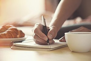 copywriter who works for a dental marketing agency that is writing a blog on pen and paper to discuss how SEO for dentists is beneficial to the crowded dental industry