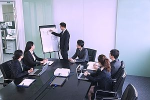 a corporate meeting between a law firm marketing agency and an attorney to discuss their proposed digital marketing strategy