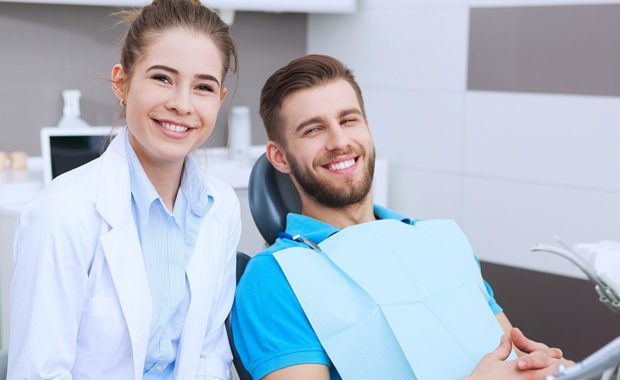 a dentist with her new patient who found the practice through highly effective search engine marketing for dentists