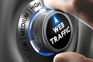 a digital marketer increasing a dial labeled web traffic to represent the effective organic SEO strategy that his firm is practicing