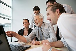 a group of business people planning their content marketing strategy for a business so that they can create more leads