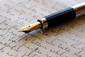 a pen resting on a piece of paper that has content written on it to symbolize the importance of content marketing for any law firm marketing plan