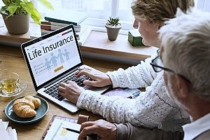elderly couple researching life insurance policies that they found with the help of marketing life insurance services