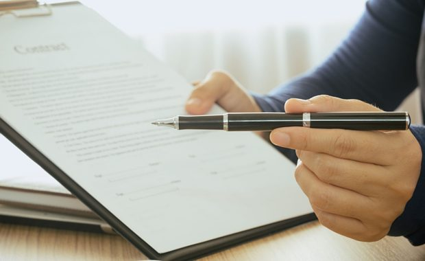 insurance agency signing a contract with a digital marketing agency so they can improve their organic lead generation