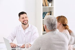middle-aged couple disscussing insurance policies with their insurance agent
