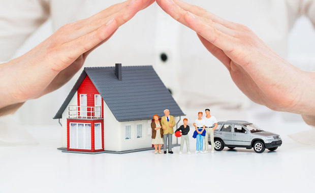 woman holding her hands over multiple figures that represent different types of insurance companies to show how insurance marketing agencies can bring them new clients.jpg