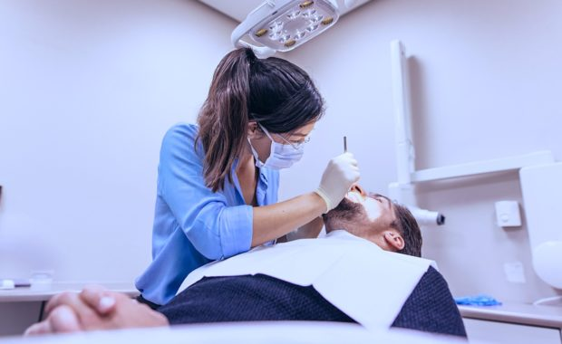 a dentist servicing a patient that is already well established with the practice but was able to recommend his friends through dental internet marketing