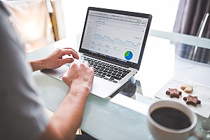 a business owner analyzing his Chantilly, VA SEO campaign metrics through Google Webmasters