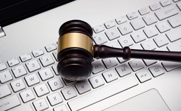 a gavel resting on top of a computer representing content marketing for law firms