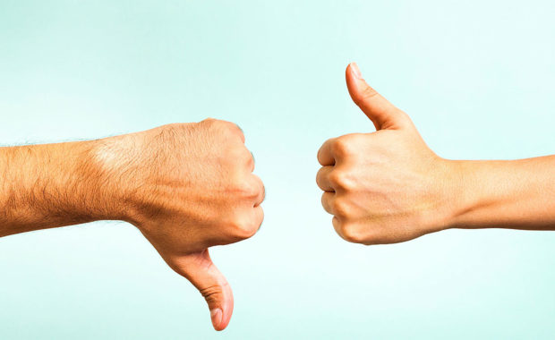 thumbs up and down representing the do's and don'ts of social media for dentists