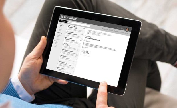 man reviewing his email marketing campaign on a tablet